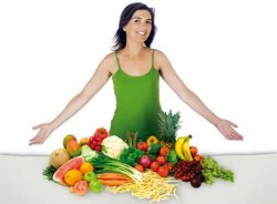woman standing near table full of vegetables