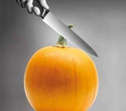 knife cutting a pumpkin