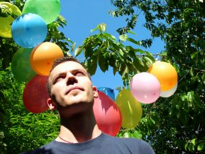 man with balloon in the background