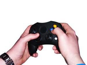Hands holding gaming controls