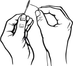 Hands trying to put a thread in the eye of a needle