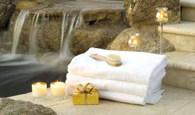Spa with towel and flowing water