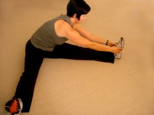 Woman performing leg stretch