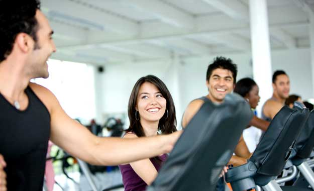 Men and women exercising in the gym