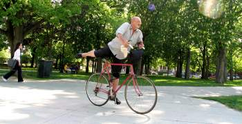 Old man getting off a bicyle