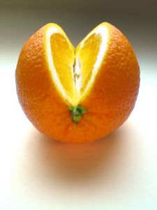 Orange cut in a way to show a heart