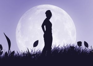 Woman's silhuoette against the full moon