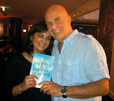 Anita Moorjani with Dr Wayne Dyer with her book Dying to be me