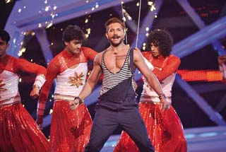 Terence Lewis performing on stage