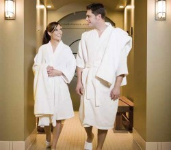 A couple in bathrobes in a spa