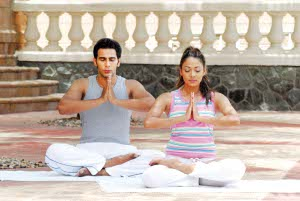 Couple doing yogasana