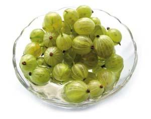 Amla fruits in a glass dish