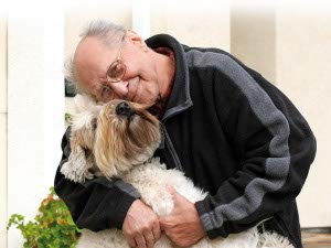 Elderly man with pet dog