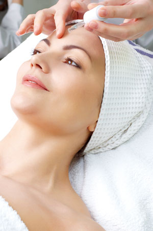 Woman under facial treatment