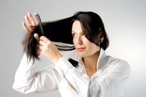 Woman combing her long hair