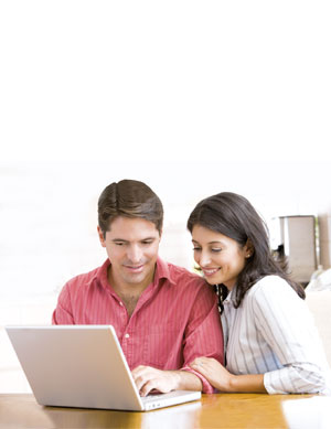 husband and wife planning finaces on a laptop