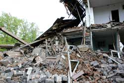 rubble of a house after an earthquake