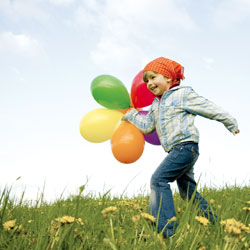 boy running with balloons