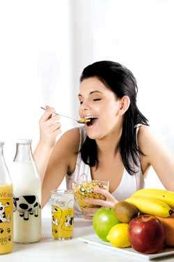 happy young woman eating oats