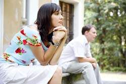 Tensed couple sitting