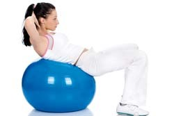 Girl working out on Swiss Ball