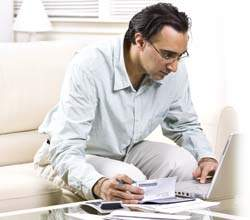 man filling his cheque book