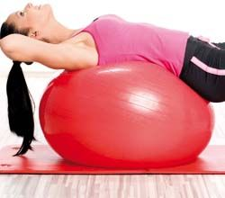 Woman lying on exercise ball