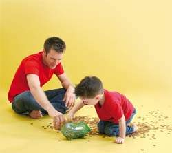 dad teaching son to use the piggy bank