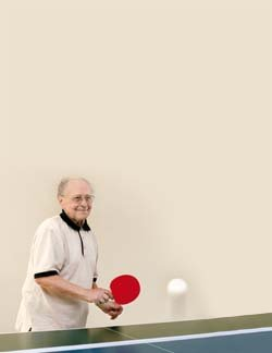old man playing tennis