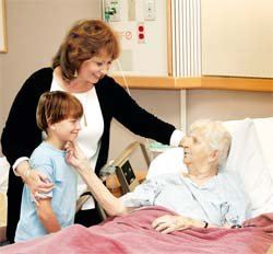 woman visiting patient in hospital