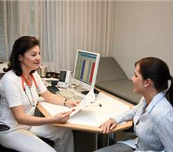 lady doctor explaining importance of health records to her patient