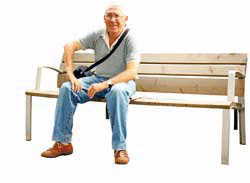 happy old man sitting on a bench