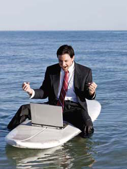 happy man in a boat with a laptop