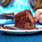 close up of woman eating cake | concept of emotional eating
