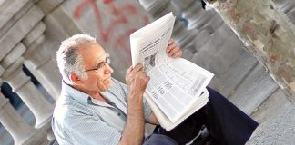 Old man reading the newpaper