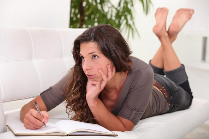 Woman writing in her diary / journaling