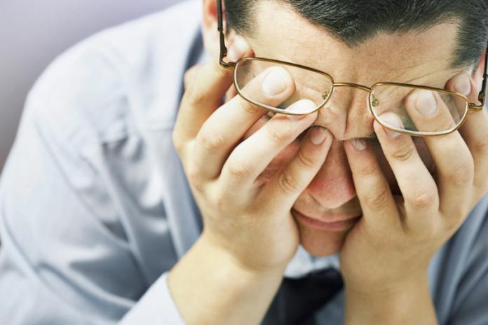 Stressed man experiencing burnout