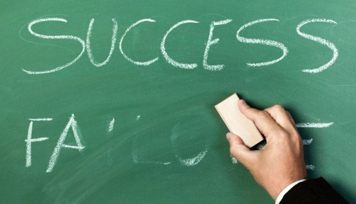 Removing failure from blackboard with the duster to move towards success