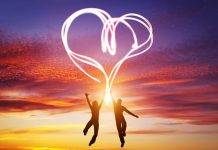 Colourful graphic depicting celebration of love with couple leaping towards heart symbol