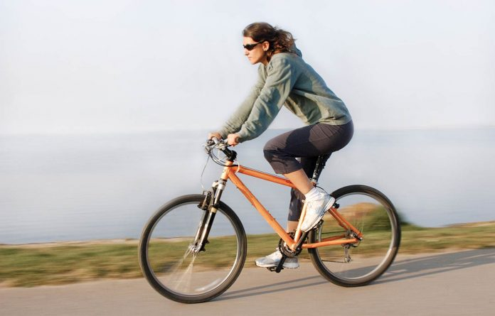 Woman riding on cycle