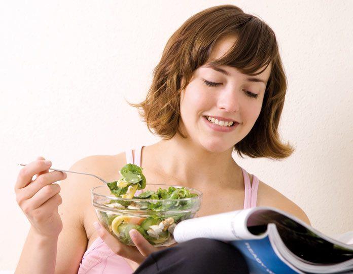 Woman having green salad