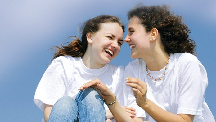 Two women laughing to each other