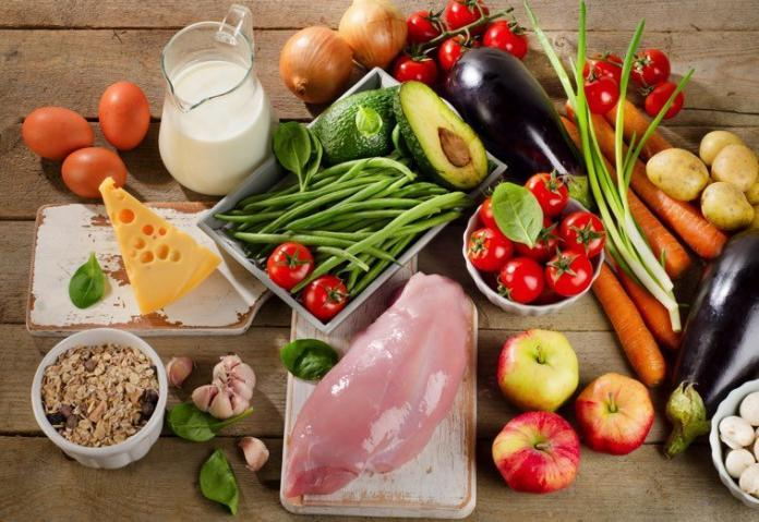 An assortment of vegetables, dairy foods, fruits rich in vitamins and minerals