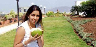 Woman having coconut water