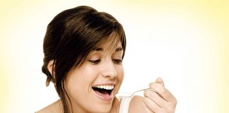Woman eating curd