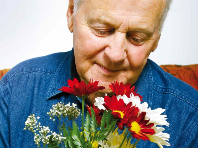 Elderly person with flowers