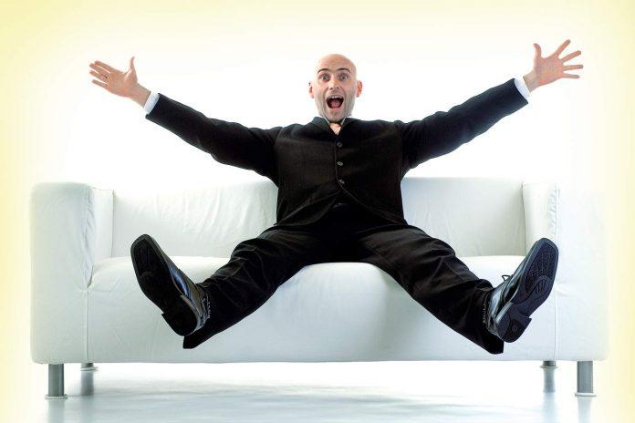 Happy man sitting on sofa