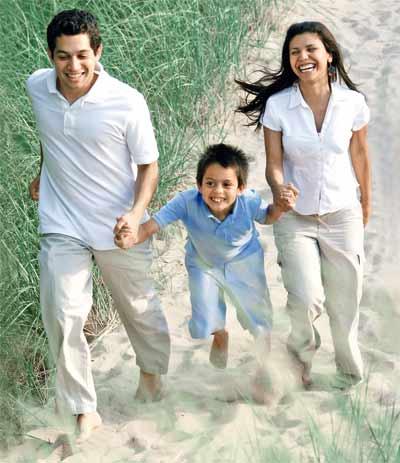 Happy family running near the beach