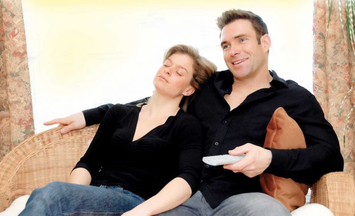 Couple relax watching TV