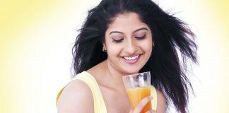 Woman having orange juice